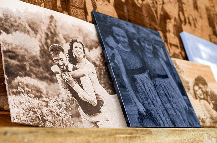 Group of wedding photos engraved on wood, leather, stone, and canvas