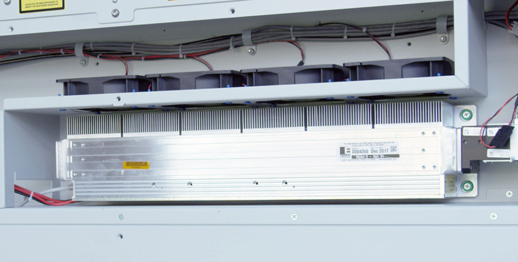 A metal co2 laser tube inside and Epilog Laser machine.