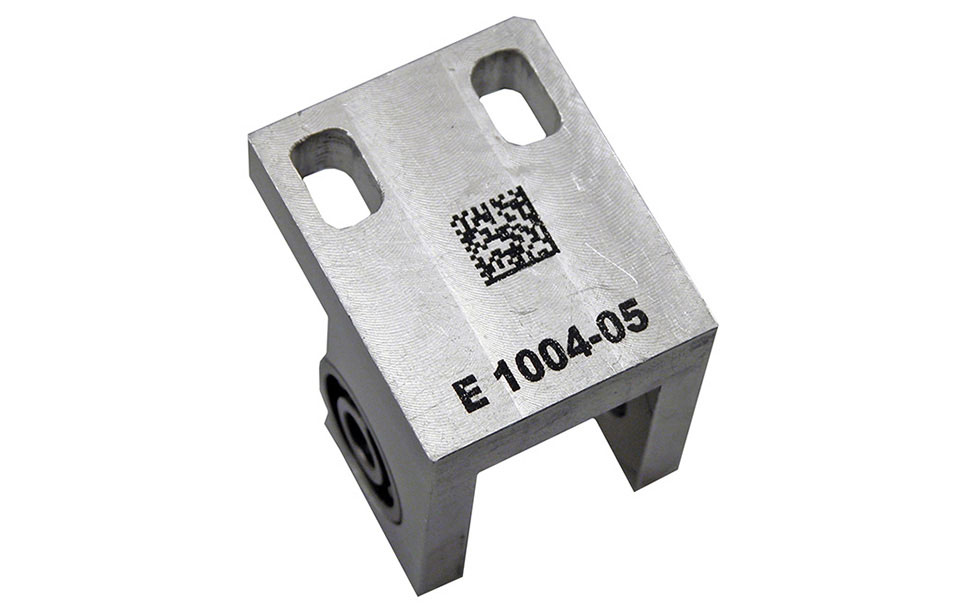 Metal part engraved with CerMark in an Epilog CO2 laser machine.