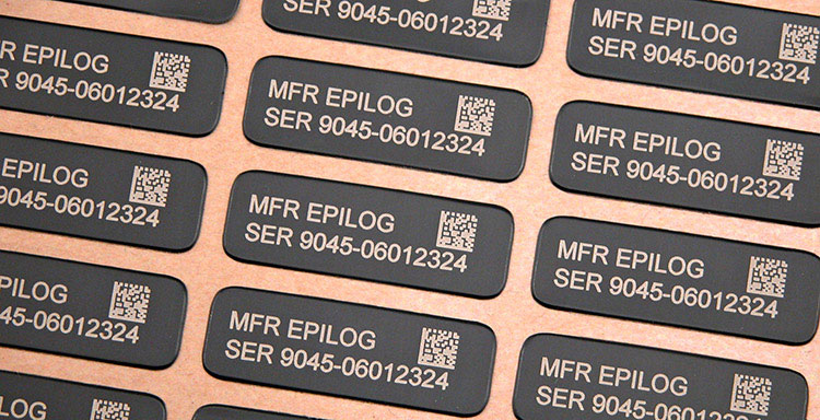 A jig of engraved identification tags