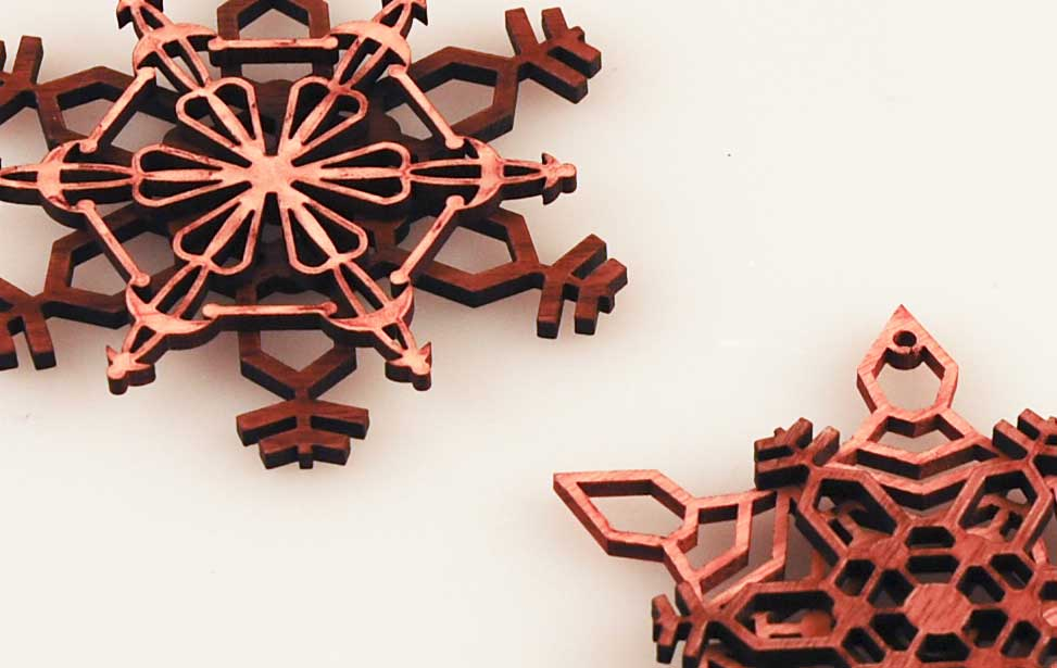 Laser cut snowflake cut from wood.