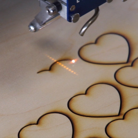Wooden Hearts Being Cut Out with an Epilog Laser
