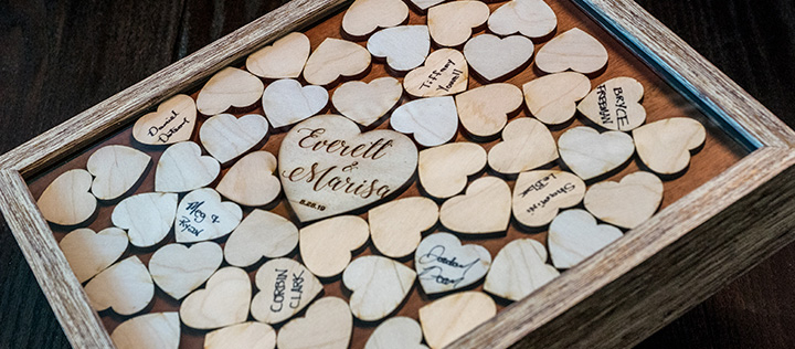 A Wedding Guestbook Shadow Box Full of Laser Cut Heart Namecards