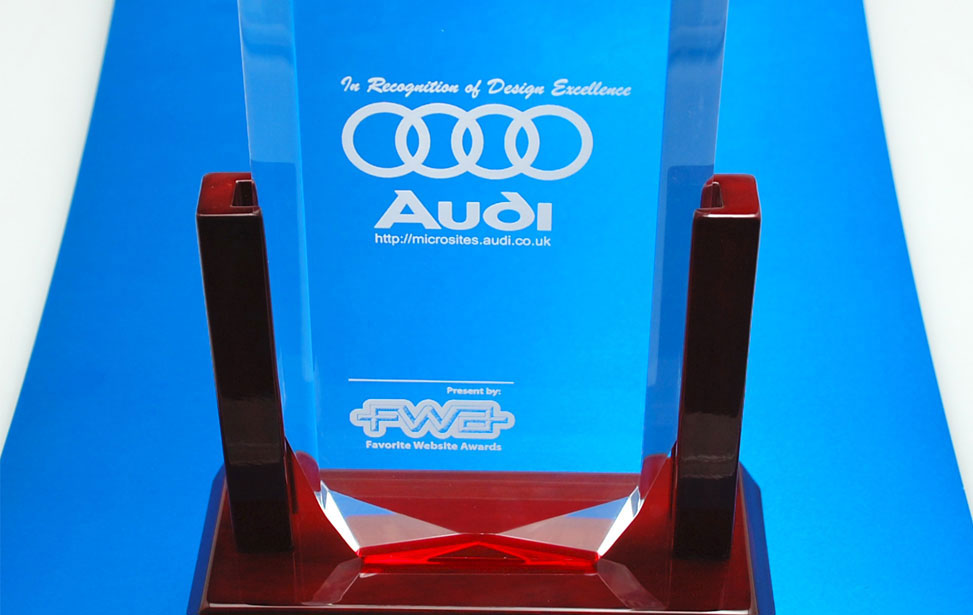 Laser engraved clear acrylic Audi award with base