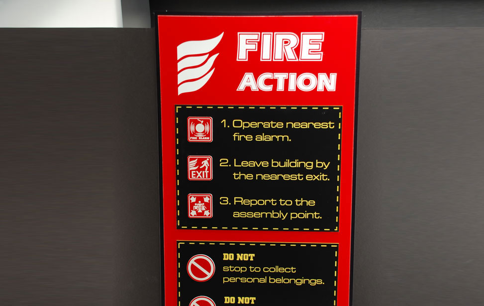 Fire action saftey red plastic signage