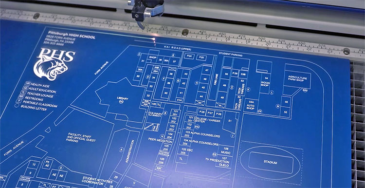 epilog laser engraving a campus map from blue engravable plastic
