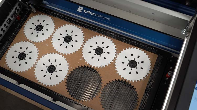 enduramark spray parts in jig at machine