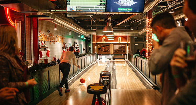 Employees bowling at the Epilog company holiday party.