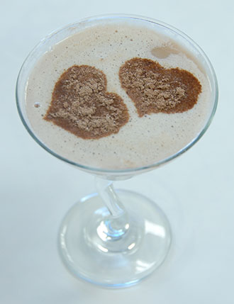 Cocoa sprinkled on drink.