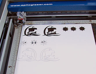 laser cutting the cardstock.