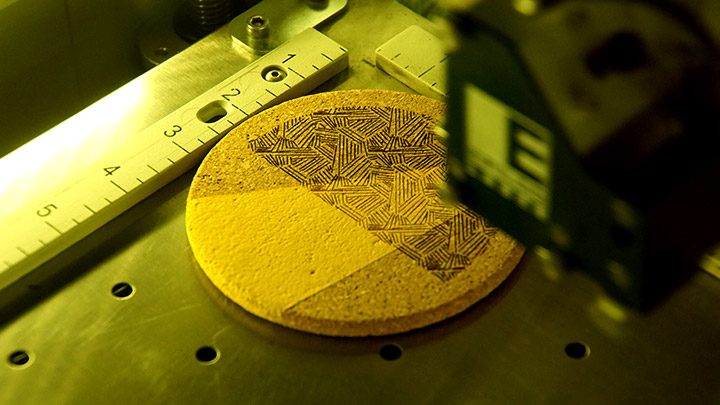 Engraving a painted cork coaster