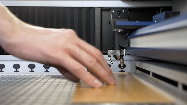 Placing wooden sheet in laser machine