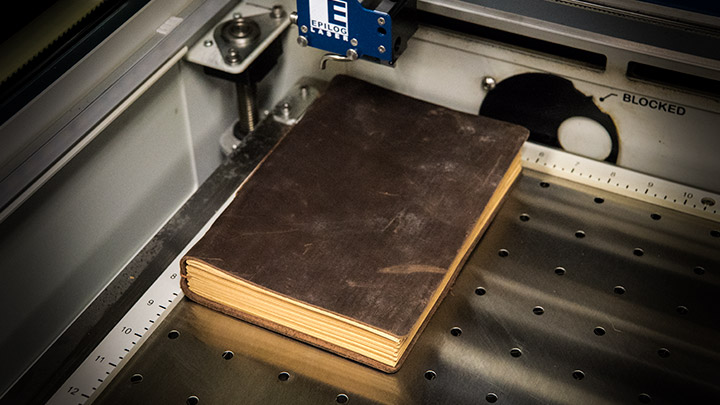 leather journal placed in the laser system